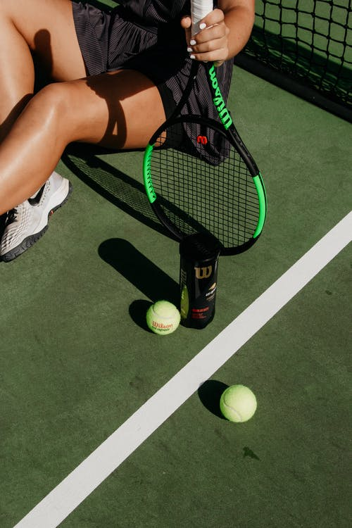 Green Tennis Balls and Black Racket