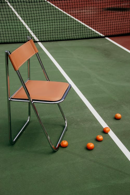 Chair on Tennis Court during Day