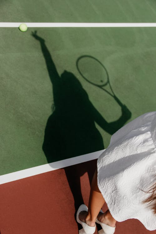 Shadow of Woman Playing Tennis