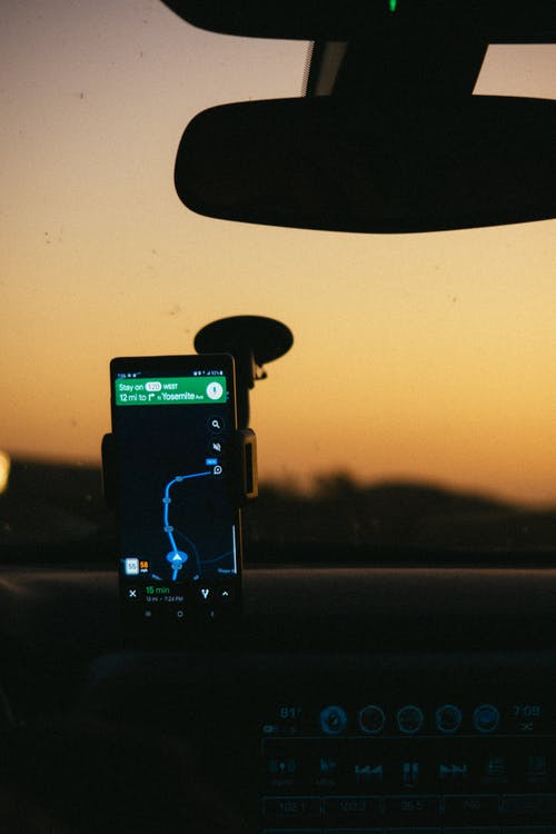 Smartphone Displaying Gps Map on Holder Inside Car