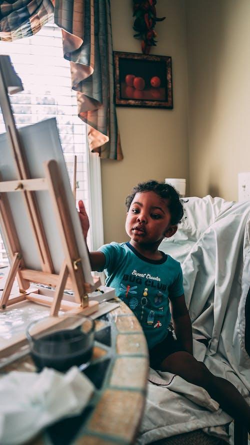 Free stock photo of art, baby boy, boy painting, canvas