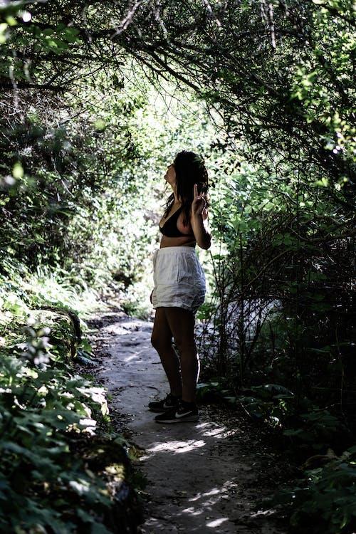 Woman Wearing Black Bra Standing Beside Green Plants