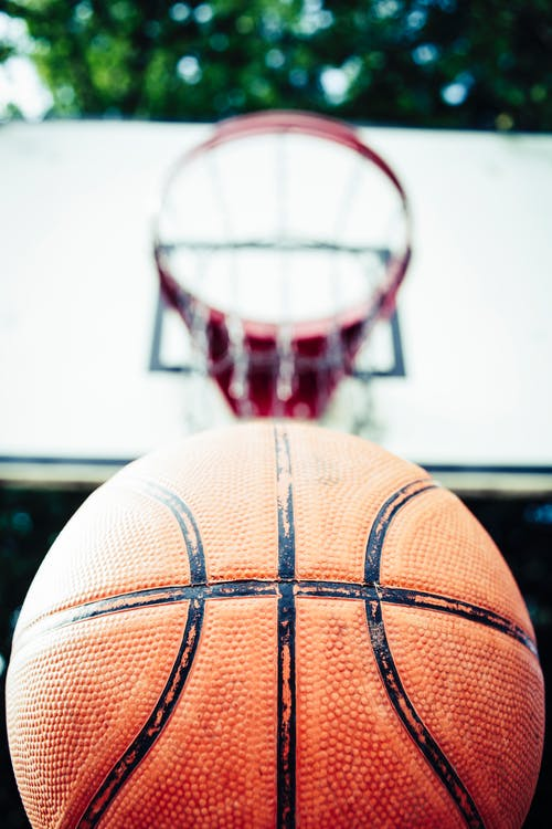 Basketball Near Basketball Hoop
