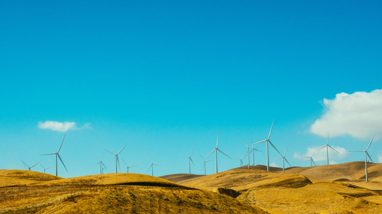 Wind Turbines Under Blue Sky