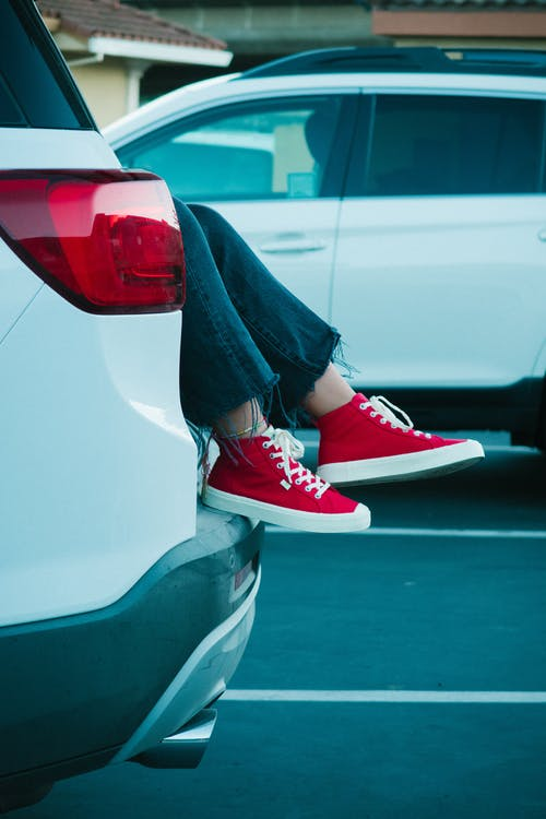 Person in Suv Wearing Red-and-white Shoes
