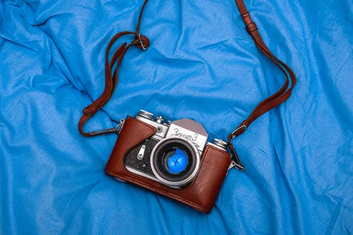 Brown and Black Dslr Camera