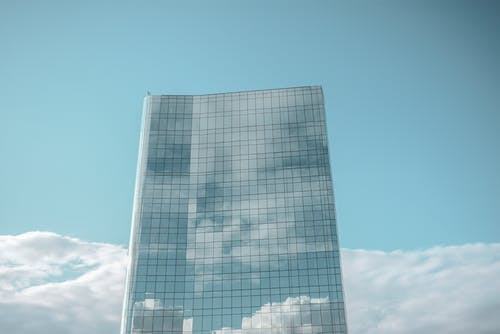 Photo of High-rise Glass Building Under Blue Sky