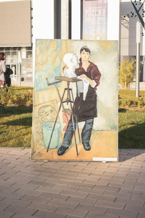 Man Wears Black Apron Painting