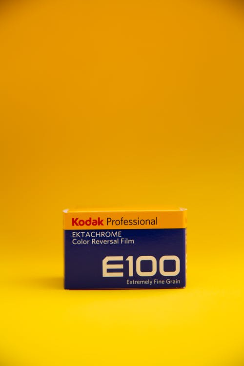 Kodak E100 Professional Ektachrome Color Reversal Film Box on Yellow Surface