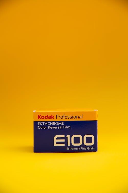 Kodak E100 Professional Ektachrome Color Reversal Film Box on Yellow Surface