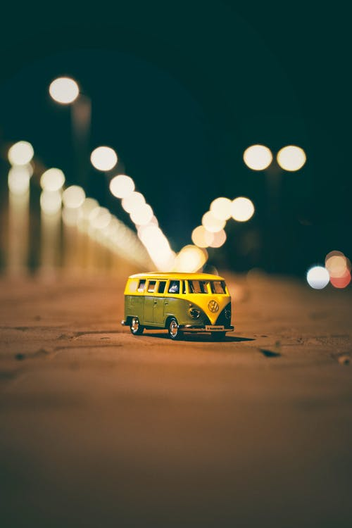 Volkswagen Van Diecast Model on Street With Bokeh Background