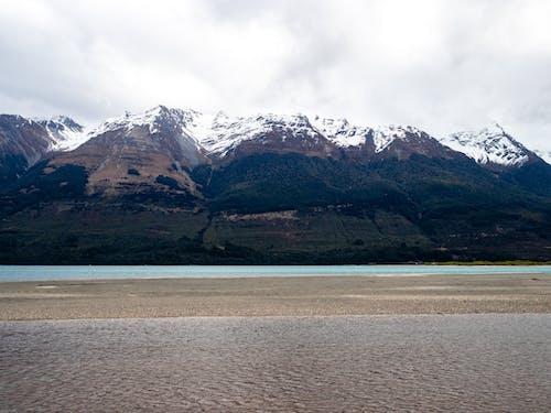 Foto profissional grátis de glenorchy, lago, montanha, montanha coberta de neve