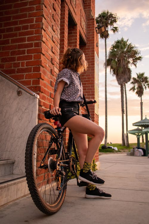 Photo Of Woman Beside Bicycle