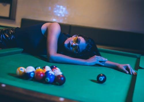 Woman Lying on Pool Table