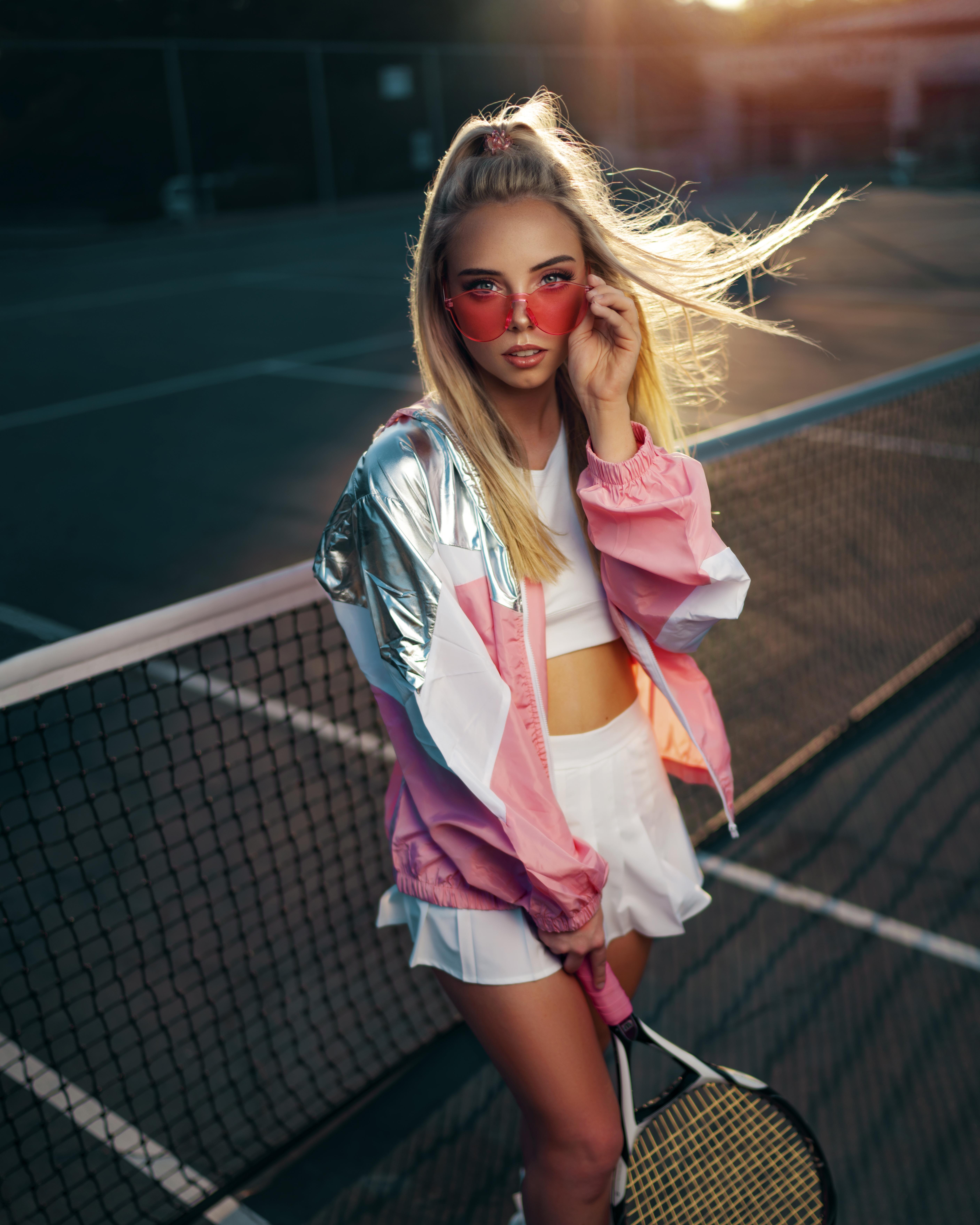 photo of woman holding tennis racquet