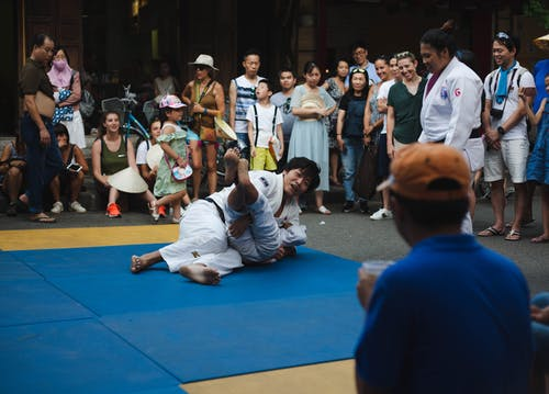 People Sitting on Blue Floor