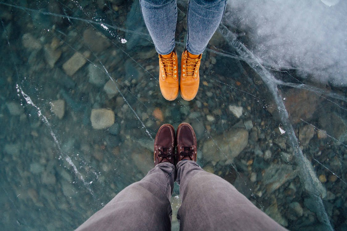 Two Person Wearing Shoes in Front of Each Other