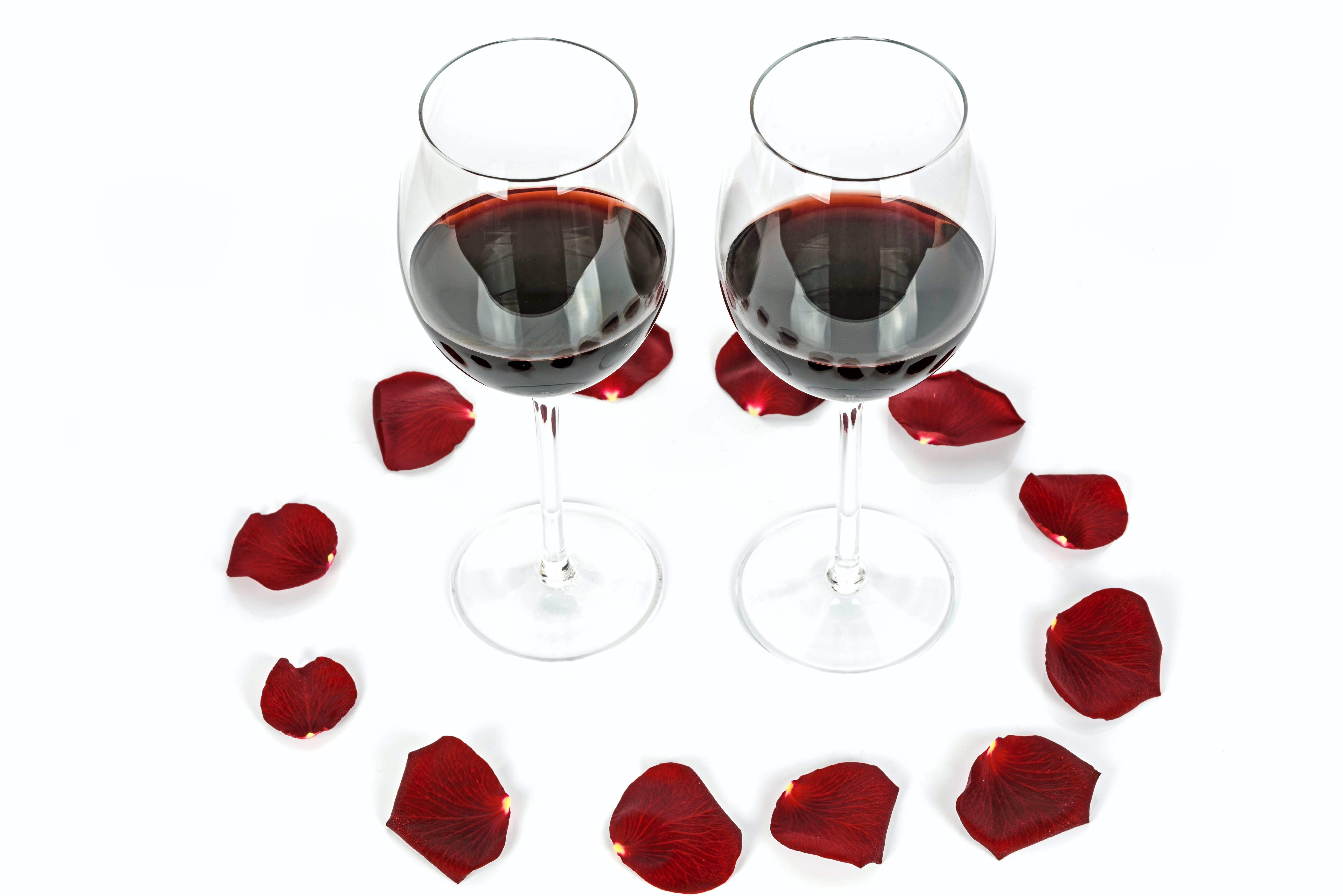 Two Wine-filled Glasses Surrounded by Petals