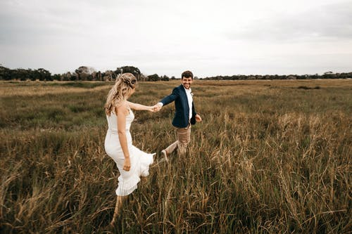 Couple Walking on Grass