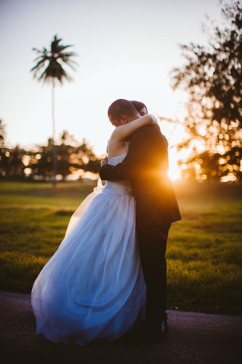 Photo of Wedded Couple Hugging