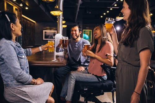 Group of People Drinking Beer and Having Fun