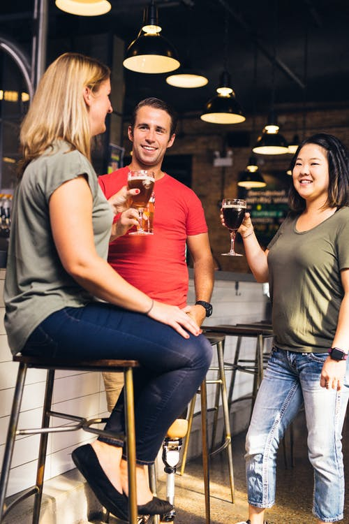 Three People Having Conversation Inside Bar