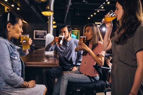 People Drinking Beverages Inside Bar