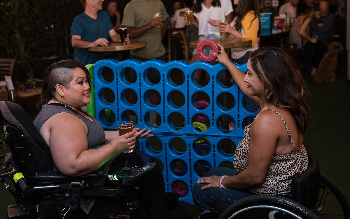Women Playing Connect Four in a Bar
