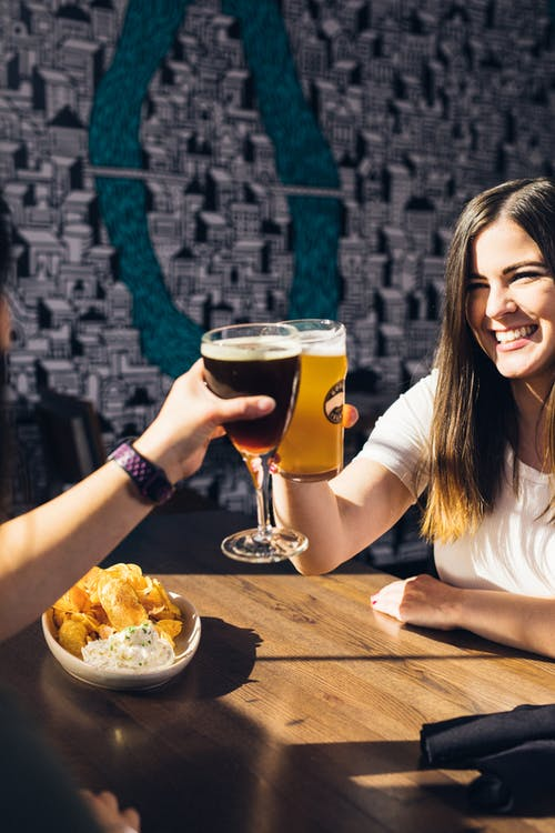 Two People Cheering Drinks