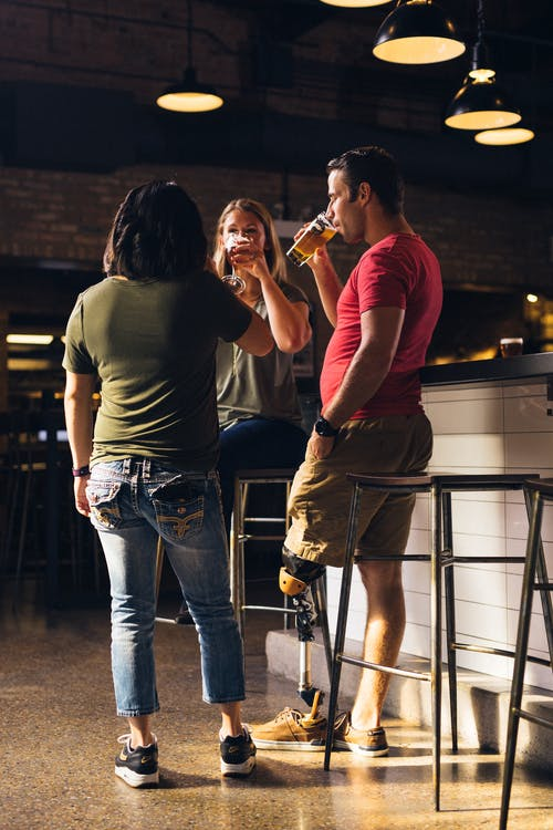 Three People Holding Drinking glasses