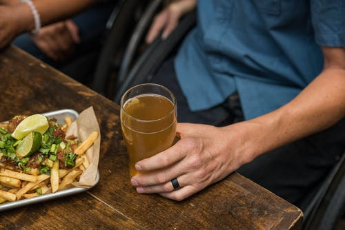 French Fries and a Glass Filled with Beer