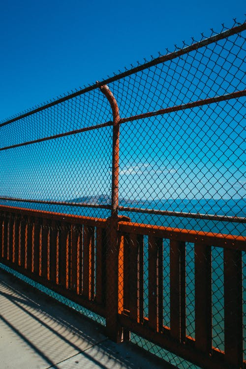 Chain Link Fence On A Bridge