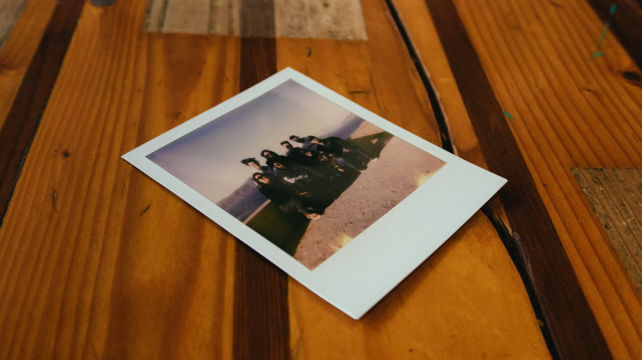 Instant Photo on Brown Wooden Table