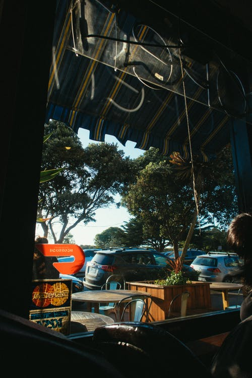 View Of Parked Cars From Inside A Restaurant
