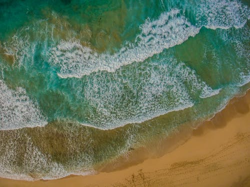 Bird's Eye View of Waves Rushing To The Shore
