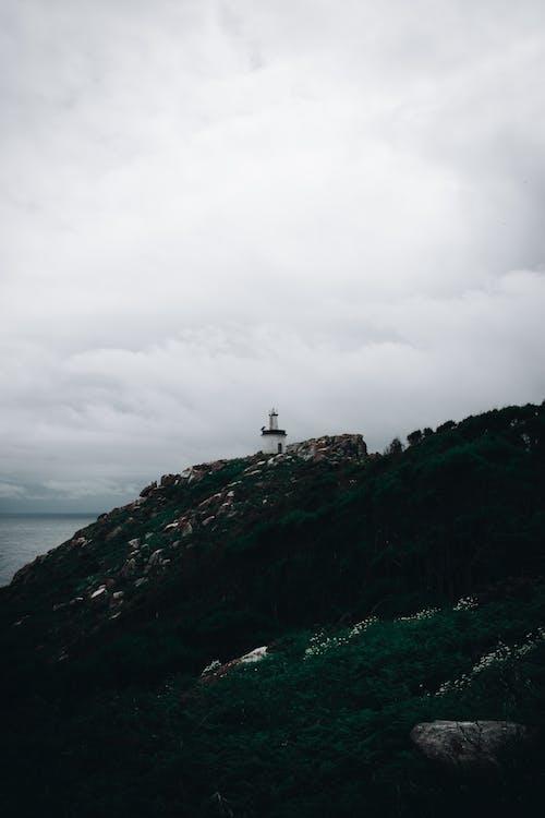 Ingyenes stockfotó felhős, tengerpart, világítótorony témában