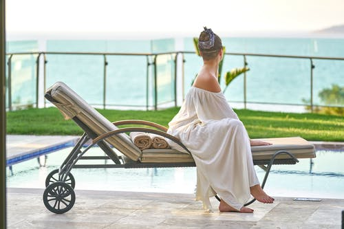 Woman Sitting On Lounge Chair