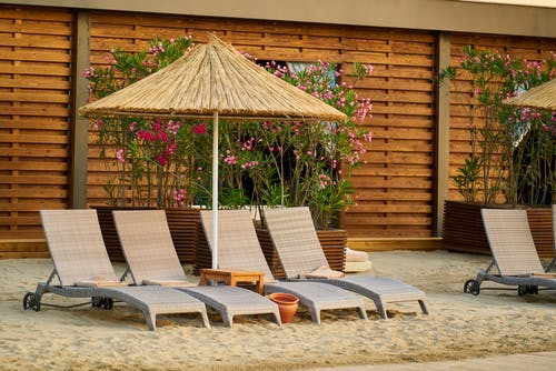 Wicker Outdoor Lounge Chairs On Sand