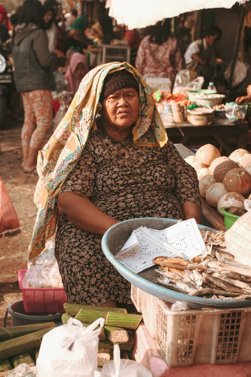 Sitting Woman Selling Dried Fish