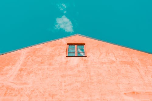 Low-angle Photography of Red Concrete House