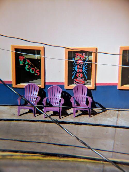 Three Purple Plastic Chairs