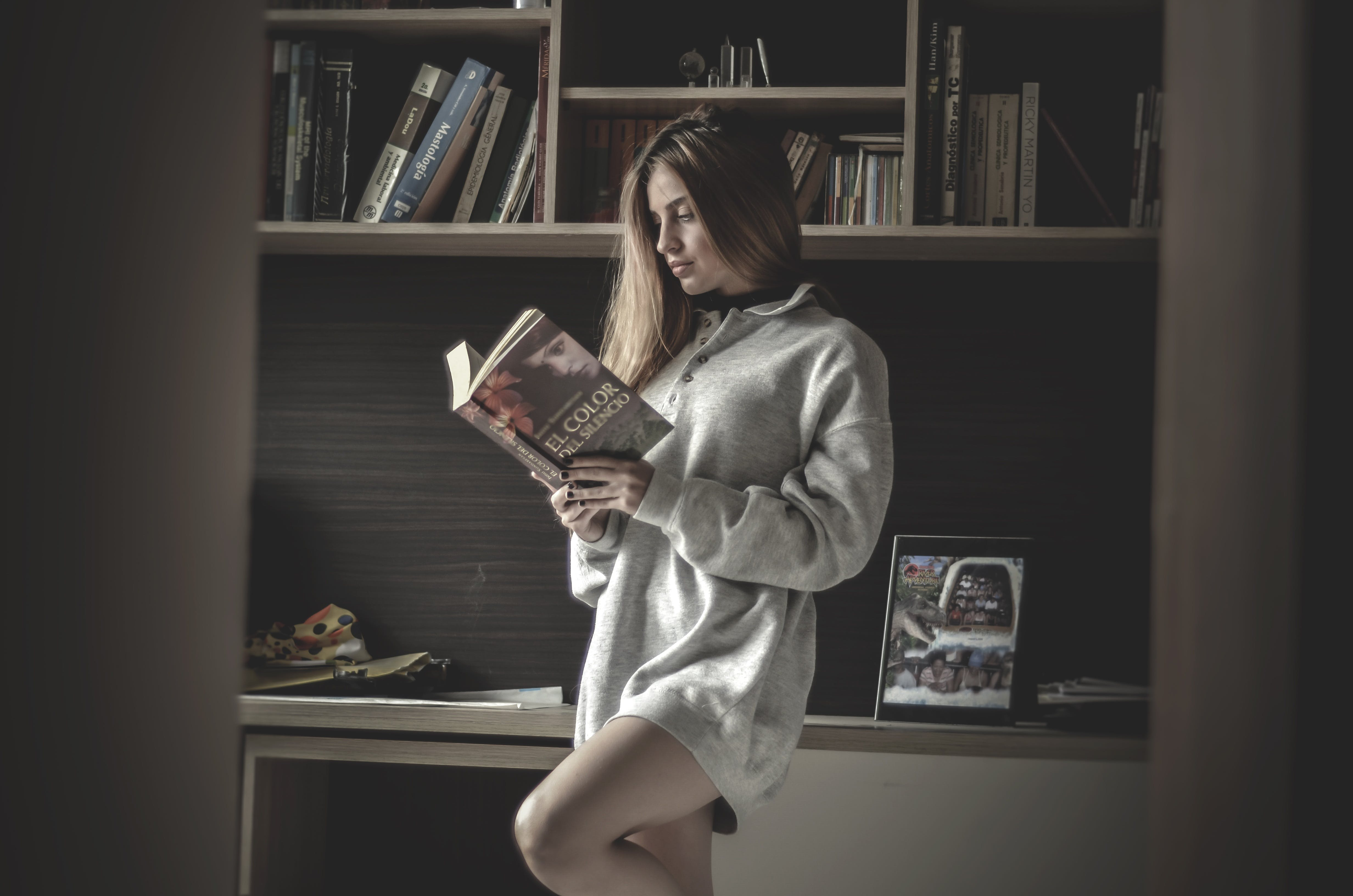 Woman Standing Reading Book