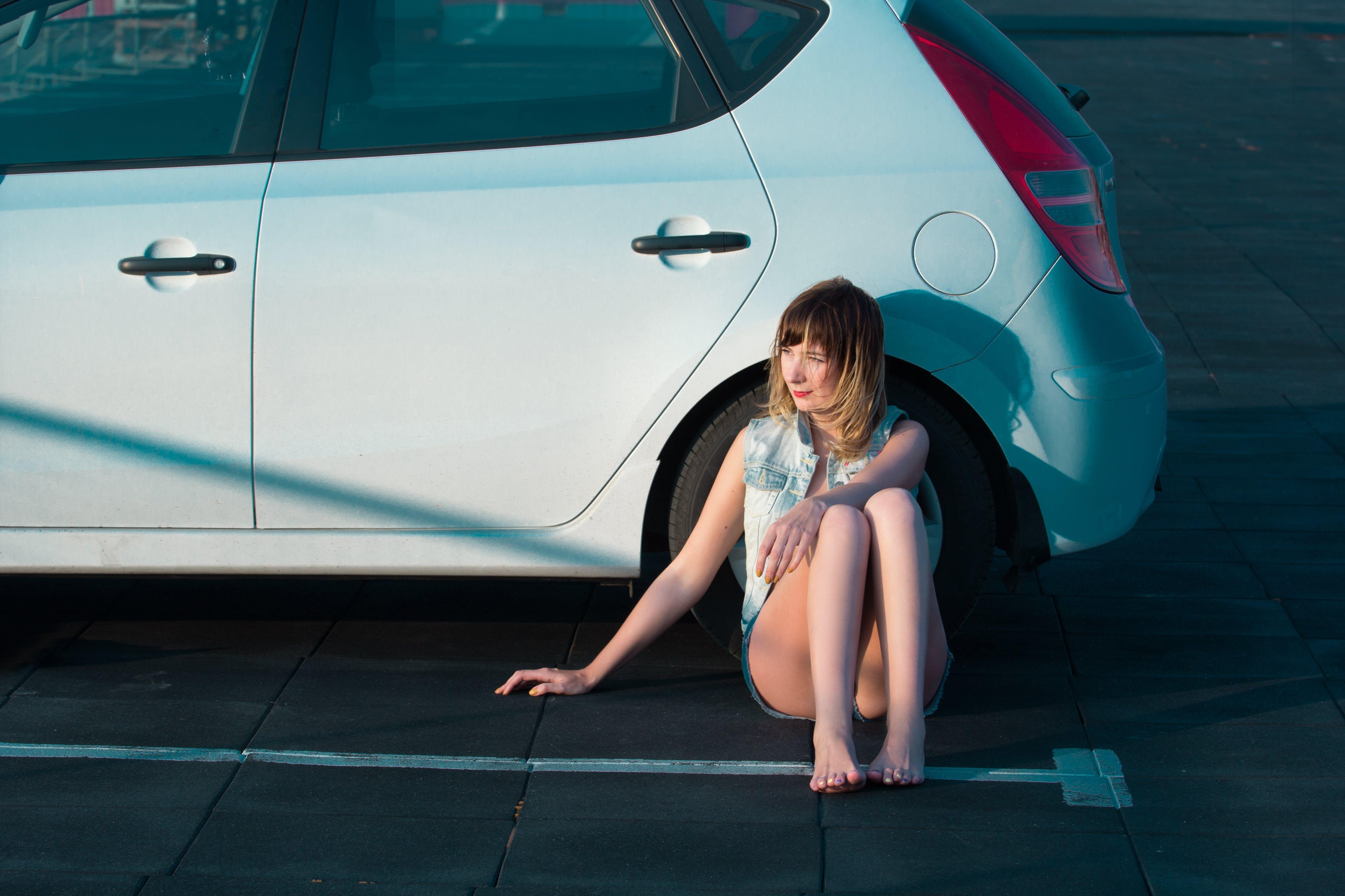 Woman Lean on Car Wheel