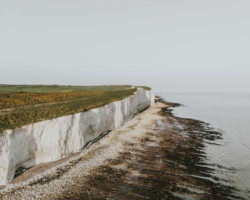 Foto profissional grátis de aerofotografia, beira-mar, costa, de cima