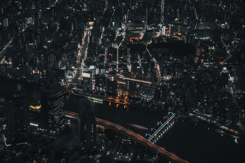 Aerial Photo of City Buildings During Night