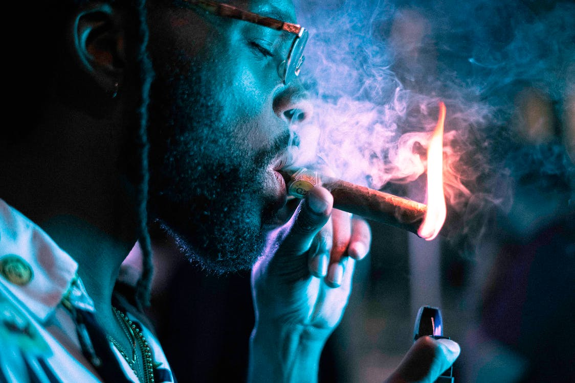 Close-Up Photo Of Man Smoking Cigar