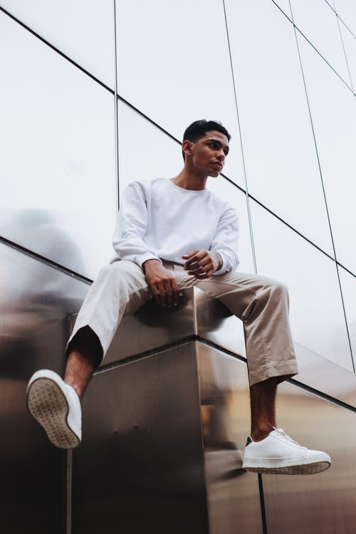 Man in White Sweater and Beige Pants