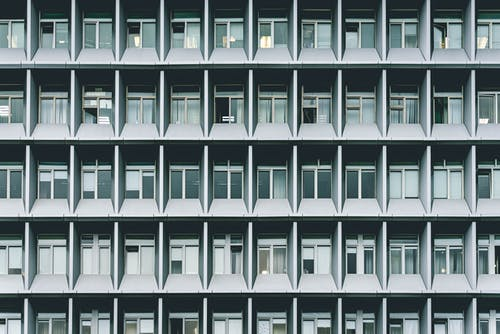 Grayscale Photography of Concrete Building Windows