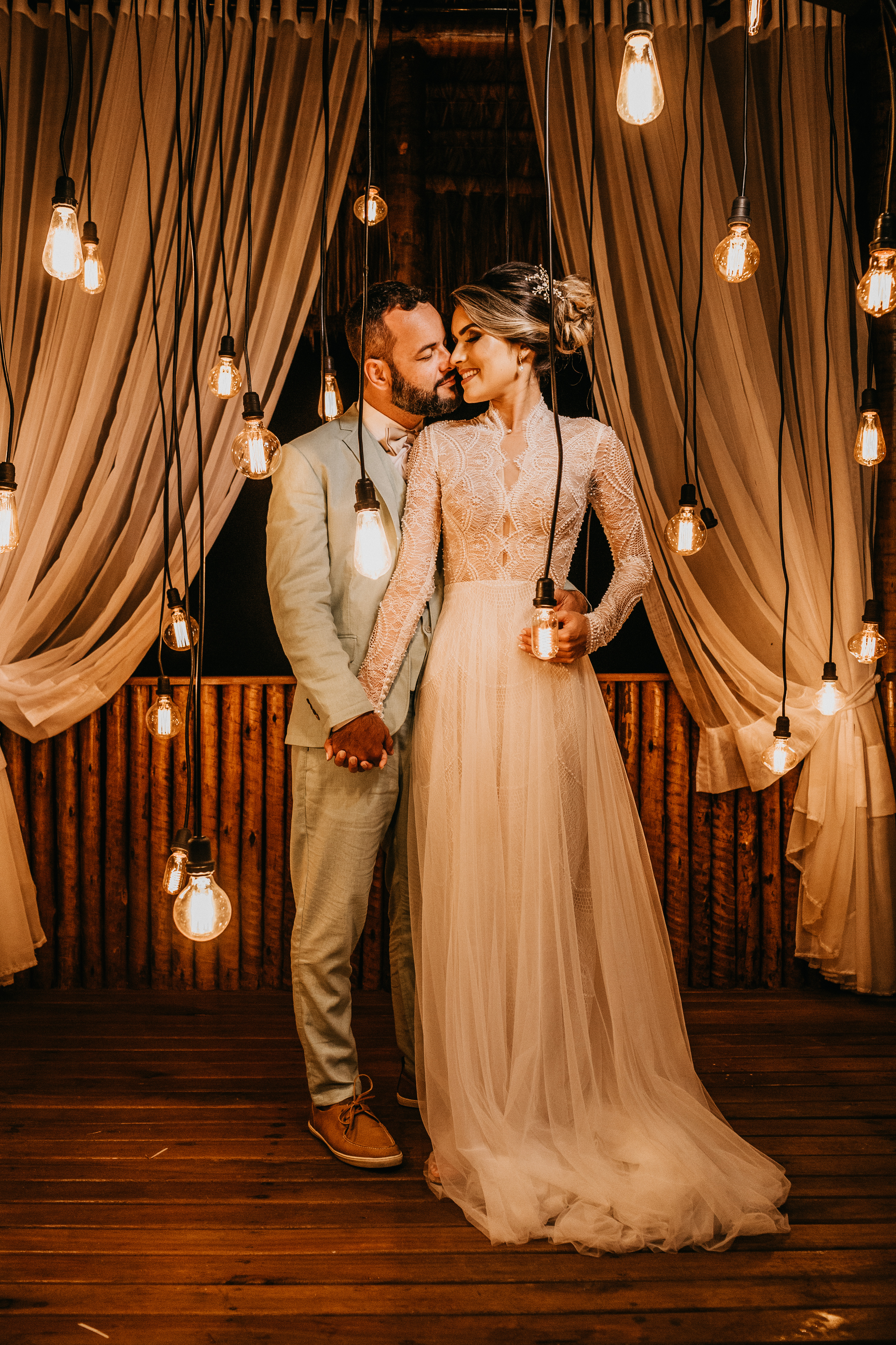 Couple Standing Near Pendant Lights