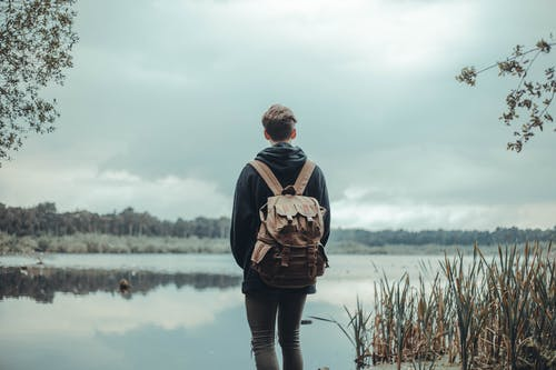 Person Standing Near Body of Water